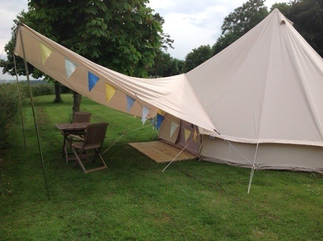 Bell Tent with front awning bunting and duck boards & Bell Tent