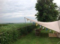 Side view of the Bell Tent awning with a dining view for 2!